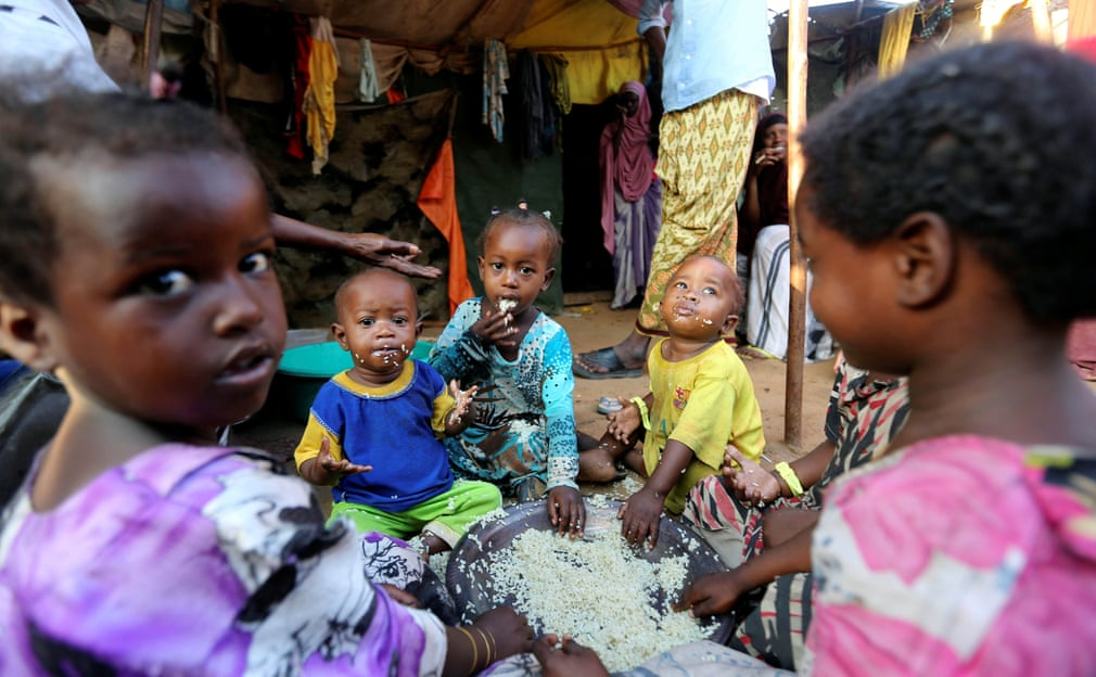 Mogadishu Somalia Children Share A Bowl Of Rice Outside Their Familys Makeshift Shelter At The Al Cadaala Camp Photograph Feisal Omar Reuters